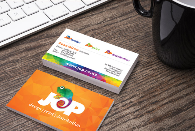 JOP business cards on desk net to coffee mug and laptop keyboard