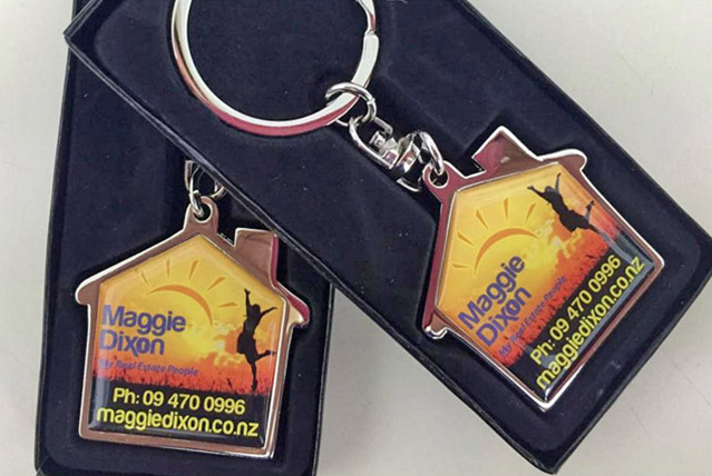 Maggie Dixon real estate key rings in a presentation box